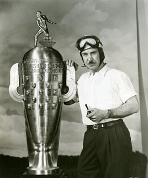 Mauri Rose with the Borg-Warner Trophy, awarded each year to the winner of the Indianapolis 500 Indy Car race. Rose was followed home by his Blue Crown Spark Special team-mate Bill Holland, the first time team-mates had finished in the top two spots