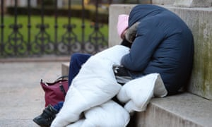 Two people with blanket sleeping rough