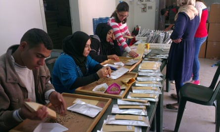 Staff at the International Centre for Agricultural Research in the Dry Areas in Torbol, Lebanon, sort through seed specimens delivered from the global seed vault in Svalbard, Norway.