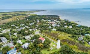 View of Ocracoke lighthouse and shoreline, North Carolina, USA.