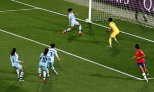 The ball hits the post before Thailand's keeoer Waraporn Boonsing scores an own goal and Chile's first.