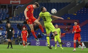 Wales' Daniel James leaps up and plants a header into the net to give the home side the lead.
