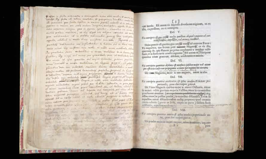 A page from Principia Mathematica, right, with Newton's notes opposite, held at Cambridge University. A European first edition has sold for £3m.