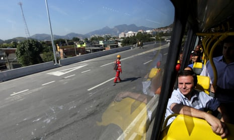 Rio de Janeiro's Mayor Eduardo Paes travels on a Bus Rapid Transit vehicle during a media tour on the Transolimpica expressway that will connect the Recreio and the Deodoro neighborhoods in the West Zone, linking the two main venues of the 2016 Rio Olympics in Rio de Janeiro, Brazil, July 4, 2016. REUTERS/Ricardo Moraes