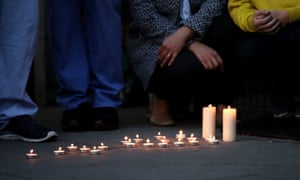 NHS workers lay down candles in memory of a colleague at Newham University hospital, the area with the highest mortality rate.