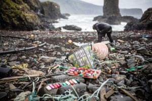 Award-winning artist Mandy Barker collects plastic debris on Canna in the Hebrides, Scotland.