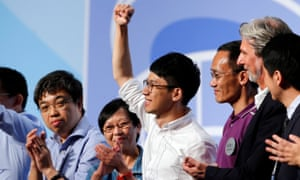Nathan Law, centre, celebrates after winning a seat on the legislative council