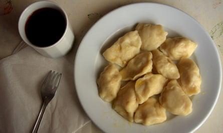 Pierogi (dumplings) and a fruit compote drink in a Krakow milk bar.