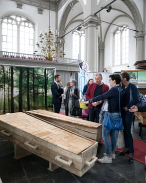 Visitors look at wooden coffins at a funeral expo in Amsterdam last weekend.