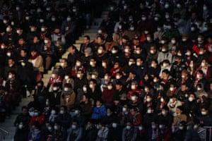Fans wear face masks at a football match in Kobe, Japan