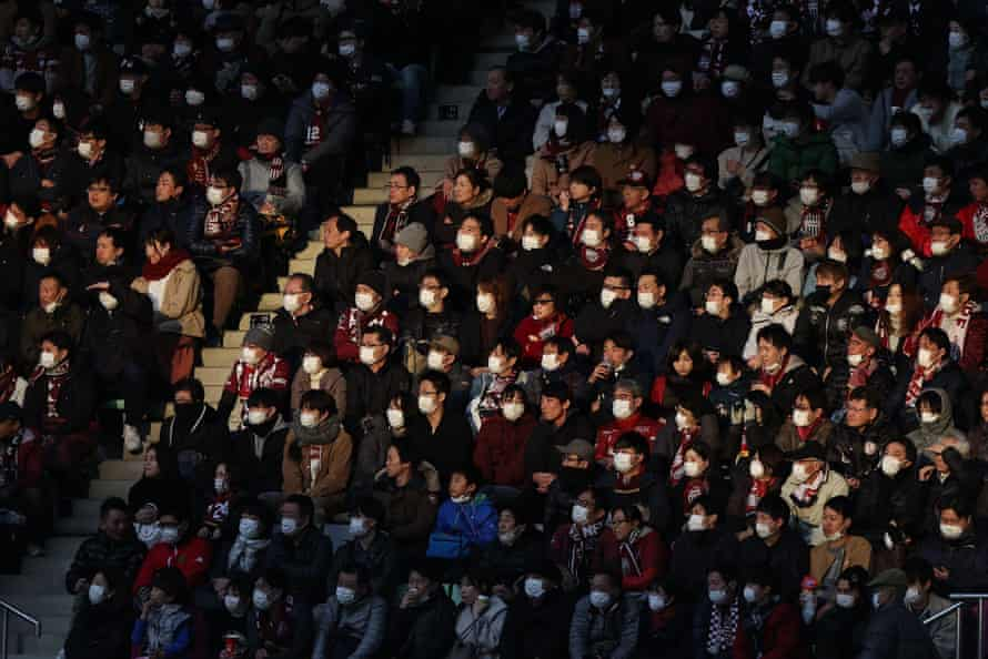 Fans wear face masks at a football match in Kobe, Japan.
