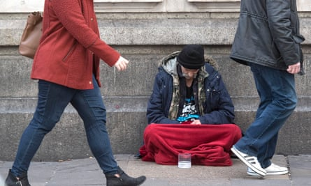 A homeless person outside Victoria Station in London