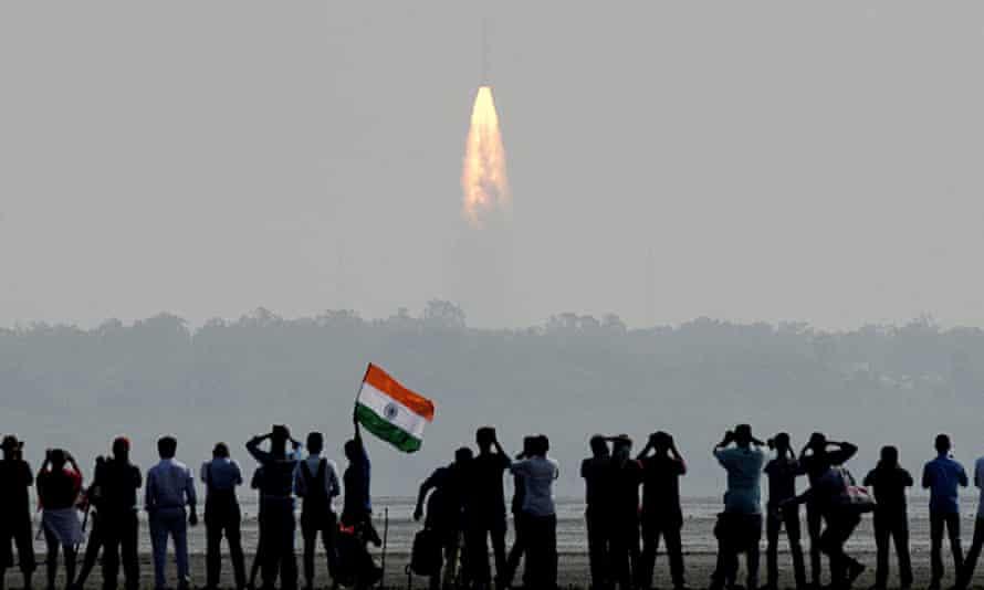 Onlookers watch rocket launch in Sriharikota, India