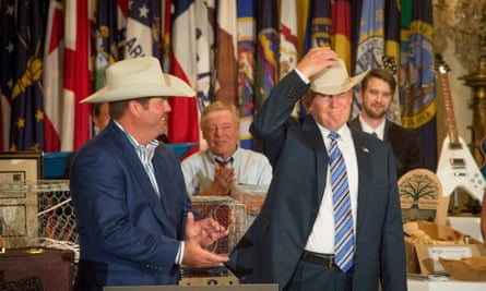 Trump tries on a US-made Stetson hat at a Made in America event at the White House.