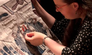 An embroiderer at work on the final section of the Game of Thrones tapestry