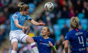 Ellen White of Manchester City Women outjumps the Chelsea defence. City are the leaders of the WSL.