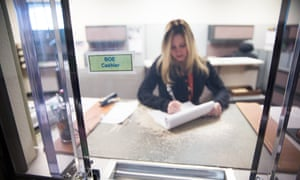 California Board of Equalization tax technician Kelly Loessberg logs payments in Sacramento, California.