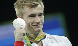 Jack Laugher holds his silver medal