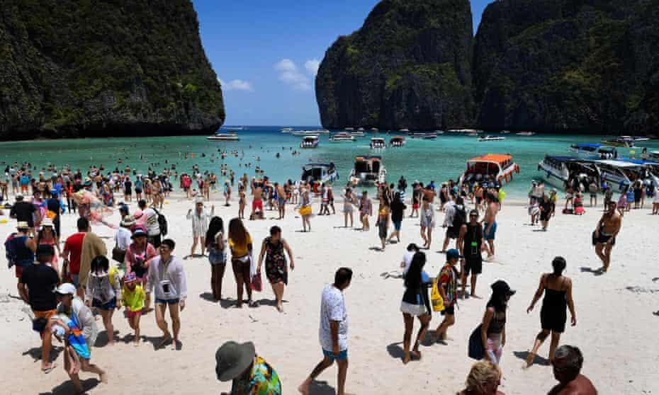 Tourists relax on Thailand's Maya Bay beach