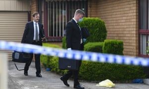 Detectives arrive at the home in Tullamarine on Friday