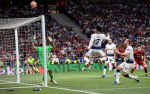 Tottenham's Son Heung-min heads over.