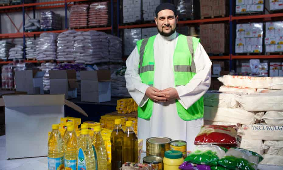 Muslim chaplain Adam Kelwick, photographed in a warehouse in Turkey, with goods destined for Syrian refugees.