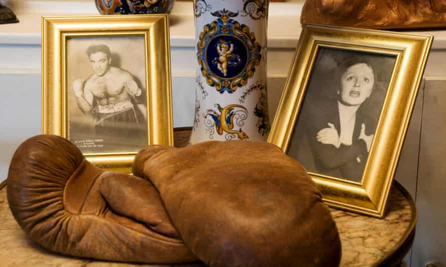 Boxings gloves and portraits of Edith Piaf and Marcel Cerdan on display at Musée Edith Piaf, Paris, France