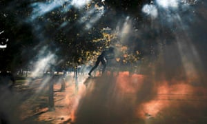 Tear gas surrounds a statue on Syntagma square during clashes between police and protesters in Athens.