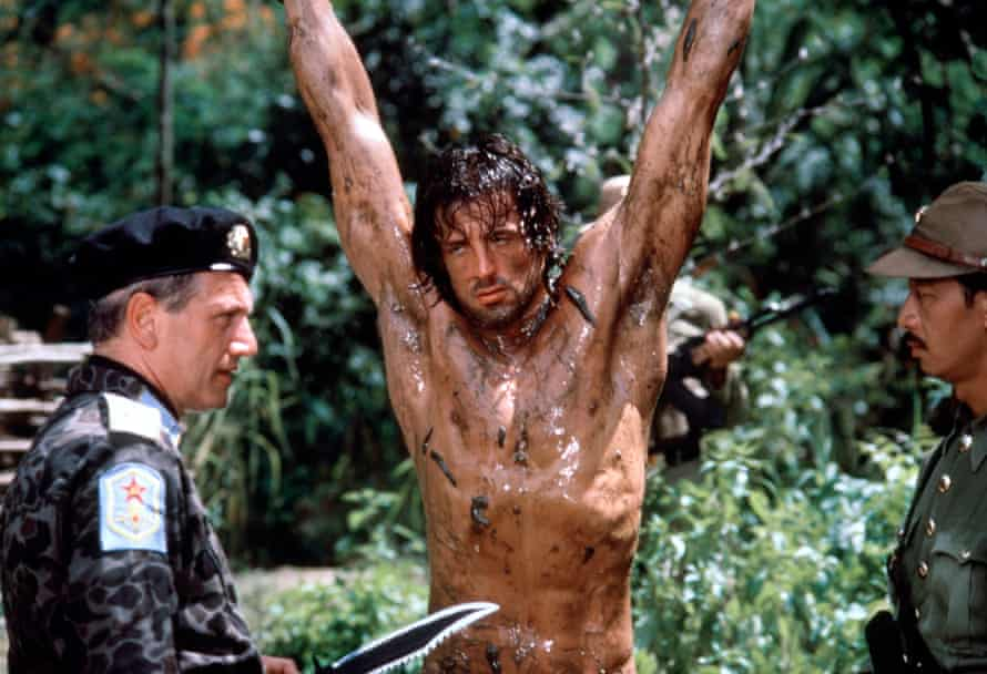 Hollywood hunter … Berkoff with Sylvester Stallone and George Cheung in Rambo: First Blood II.