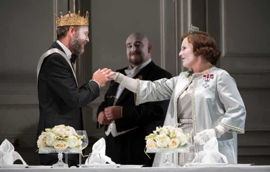 William Dazeley as Claudius and Louise Winter as Gertrude, with Jeffrey Lloyd-Roberts, behind, as Polonius.