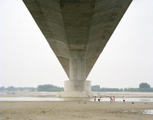 A family spending the weekend under a bridge, Shandong, China, 2011