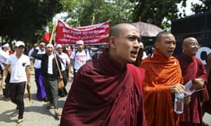 Monks and protesters march to denounce foreign criticism of the country's treatment of stateless Rohingya Muslims in Rangoon.