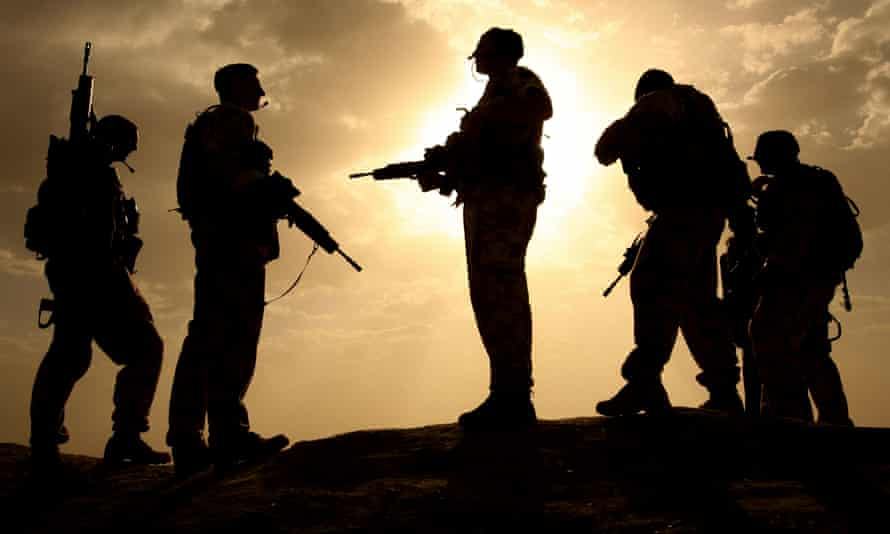 Is Britain guilty of crimes of aggression? … British soldiers are silhouetted against the sky in Helmand.