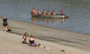 Boating and dog walking on the banks of the Thames in west London
