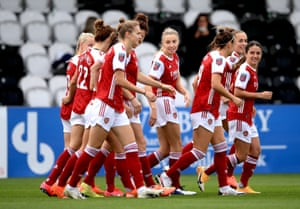 Arsenal players celebrate after teammate Katie McCabe scores their sides first goal of the game.