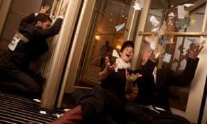 Protesters throw fake money