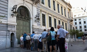 People line up outside a National Bank branch in Athens, Greece.