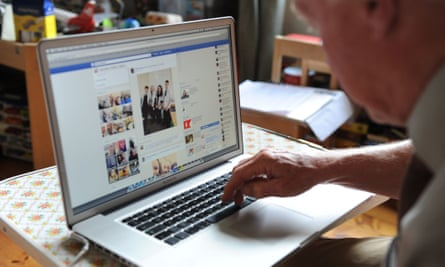 An older person using Facebook on a computer