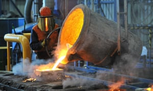 A factory worker pours molten iron at a steel mill in Geelong, Australia.