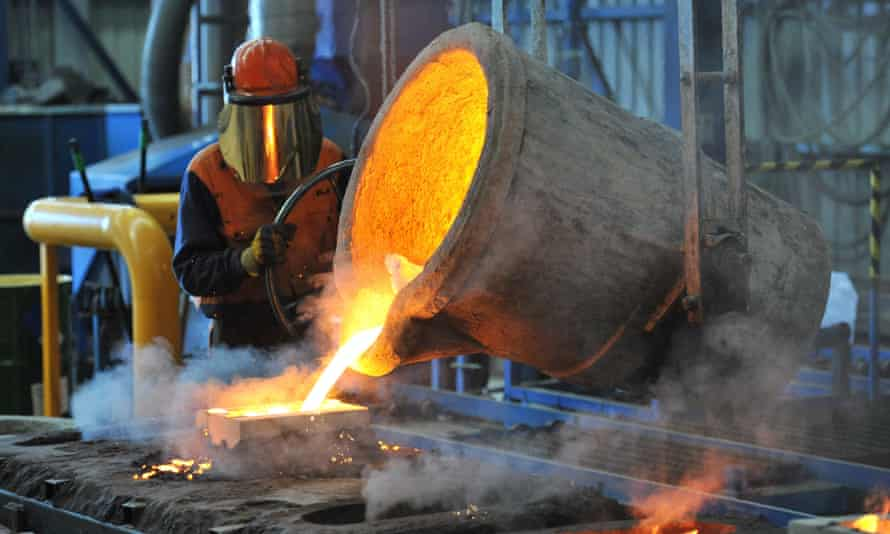 A factory worker pours molten iron at a factory in Geelong