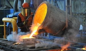A factory worker pours molten iron at Backwell IXL in Geelong.