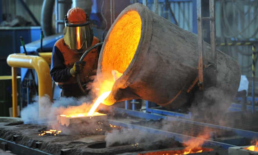 A factory worker pours molten iron at Backwell IXL in Geelong, Victoria.