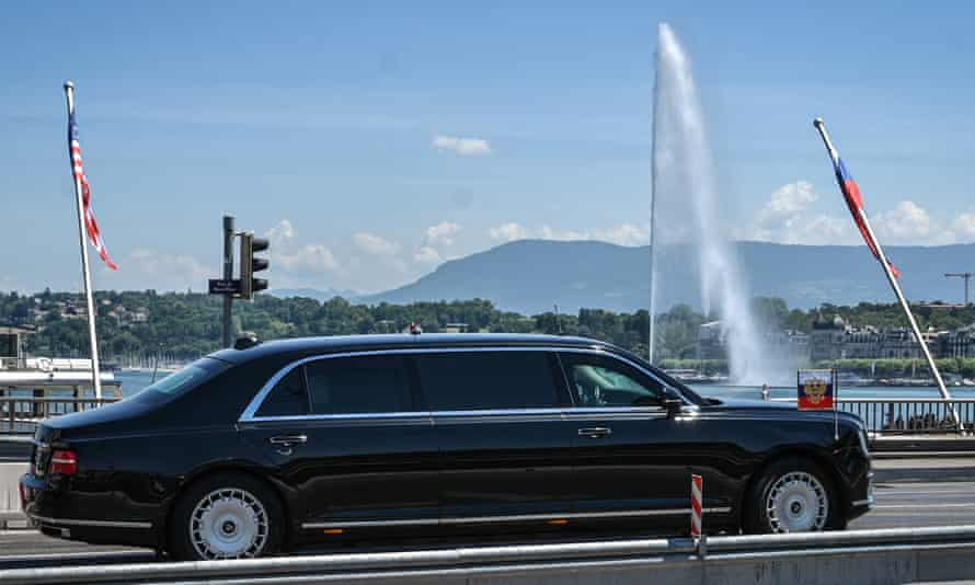 A limousine carrying Putin passes Lake Geneva ahead of the US-Russia summit with Biden.