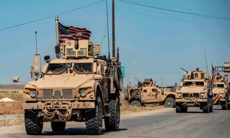 Mine-resistant ambush protected vehicles drive in Syria on 20 May.