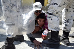 Ciudad Hidalgo, Mexico A member of Mexico's National Guard detains a migrant, part of a caravan travelling to the US, near the border between Guatemala and Mexico