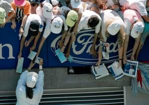 Jennifer Capriati signs autographs for fans in 1992.