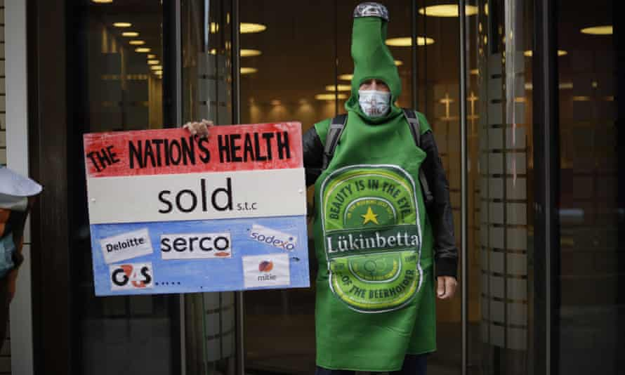 A protest outside the Department of Health and Social Care office in London over Serco's handling of the coronavirus test, track and trace system.
