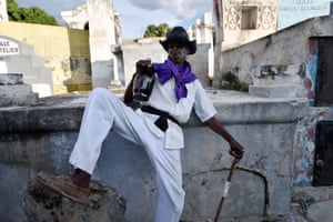 Haiti: People gather at local cemeteries and bring offerings of candles, food and bottles of rum