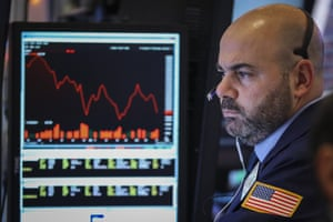 A trader works at his desk at the closing bell on the floor of the New York Stock Exchange last night