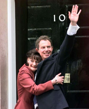 Britain's new Prime Minister Tony Blair, being hugged by his wife Cherie outside No 10 Downing Street, London, after a landslide victory in May 1997